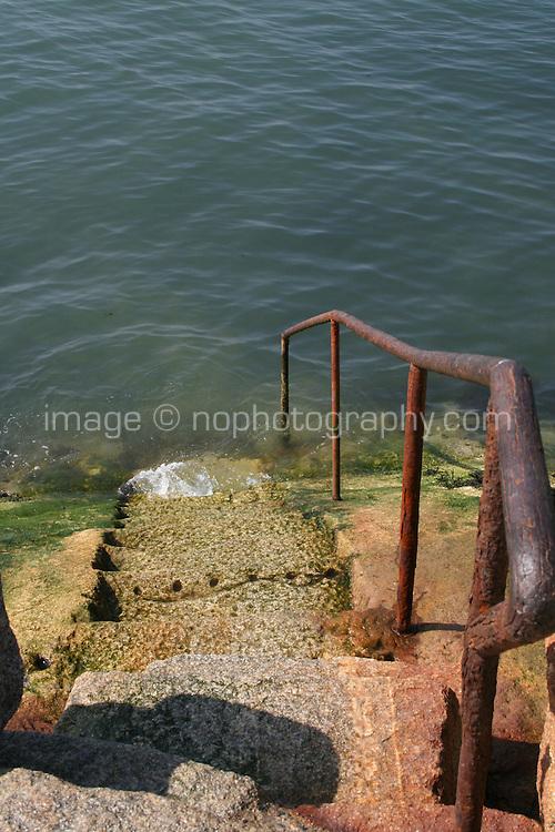 Steps with rusty handrail to the sea, Sandycove, County Dublin, Ireland