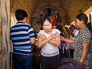 25 FEBRUARY 2015 - PHNOM PENH, CAMBODIA:  A woman dances in a Cambodian style at a Buddhist shrine on Sisowath Quay in Phnom Penh.   PHOTO BY JACK KURTZ