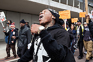 Activist leader and outspoken protester DONTE CARTER yells out to onlookers as demonstrators march through the streets of Clayton, Missouri. More than 100 people marched through the streets of Clayton today in a continuation of protests that begun last August after Michael Brown Jr. was shot and killed by a police officer in Ferguson.