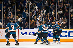 April 16, 2010; San Jose, CA, USA; San Jose Sharks right wing Devin Setoguchi (second from right) celebrates after scoring a goal against the Colorado Avalanche during the overtime period of game two in the first round of the 2010 Stanley Cup Playoffs at HP Pavilion. The Sharks defeated the Avalanche 6-5 in overtime. Mandatory Credit: Jason O. Watson / US PRESSWIRE