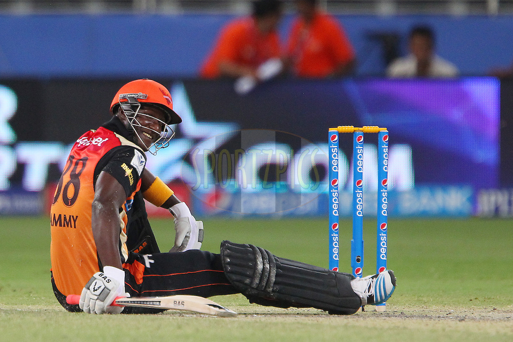 Darren Sammy of the Sunrisers Hyderabad stretches for a wide delivery and takes a tumble during match 20 of the Pepsi Indian Premier League Season 2014 between the Mumbai Indians and the Sunrisers Hyderabad held at the Dubai International Stadium, Dubai, United Arab Emirates on the 30th April 2014<br /> <br /> Photo by Ron Gaunt / IPL / SPORTZPICS