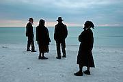 Amish at sunset on the beach at Long Boat Key, Florida.