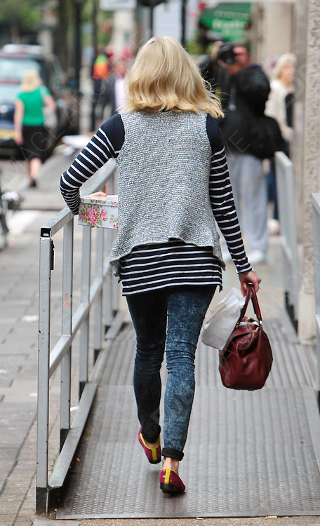 28.JUNE.2012. LONDON<br /> <br /> FEARNE COTTON ARRIVING AT THE RADIO ONE STUDIO IN LONDON. <br /> <br /> BYLINE: EDBIMAGEARCHIVE.CO.UK<br /> <br /> *THIS IMAGE IS STRICTLY FOR UK NEWSPAPERS AND MAGAZINES ONLY*<br /> *FOR WORLD WIDE SALES AND WEB USE PLEASE CONTACT EDBIMAGEARCHIVE - 0208 954 5968*