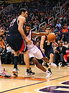 Feb. 15, 2012; Phoenix, AZ, USA; Phoenix Suns guard Ronnie Price (2) handles the ball against against the Atlanta Hawks center Zaza Pachulia (27) during the second half at the US Airways Center. The Hawks defeated the Suns 101-99. Mandatory Credit: Jennifer Stewart-US PRESSWIRE..