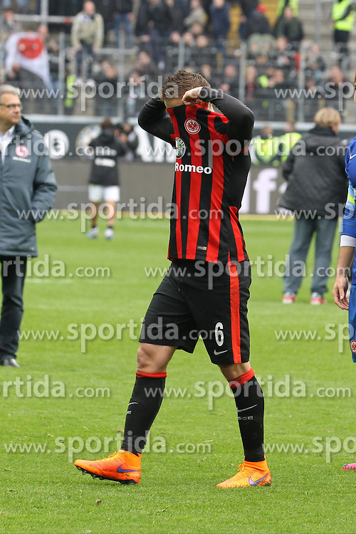 04.04.2015, Commerzbank Arena, Frankfurt, GER, 1. FBL, Eintracht Frankfurt vs Hannover 96, 27. Runde, im Bild Bastian Oczipka (Frankfurt) zerrt sich das Trikot vom Kopf // during the German Bundesliga 27th round match between Eintracht Frankfurt and Hannover 96 at the Commerzbank Arena in Frankfurt, Germany on 2015/04/04. EXPA Pictures &copy; 2015, PhotoCredit: EXPA/ Eibner-Pressefoto/ Roskaritz<br /> <br /> *****ATTENTION - OUT of GER*****