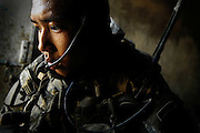 Sweat drips from the face of SSG. Le Cuong of Company A. 1st Battalion, 12th Calvary Regiment, 3rd Brigade Combat Team, 1st Cavalry Division, (attached) 1st Battalion, 38th Infantry Regiment, 4th Brigade Combat Team, 2nd Infantry Division during combined combat operations, OCT. 15, 2007 Baqubah, Iraq.