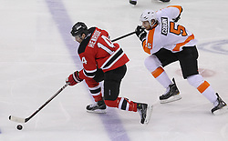 May 3, 2012; Newark, NJ, USA;  New Jersey Devils center Adam Henrique (14) skates past Philadelphia Flyers defenseman Braydon Coburn (5) on a breakaway during the second period in game three of the 2012 Eastern Conference semifinals at the Prudential Center.