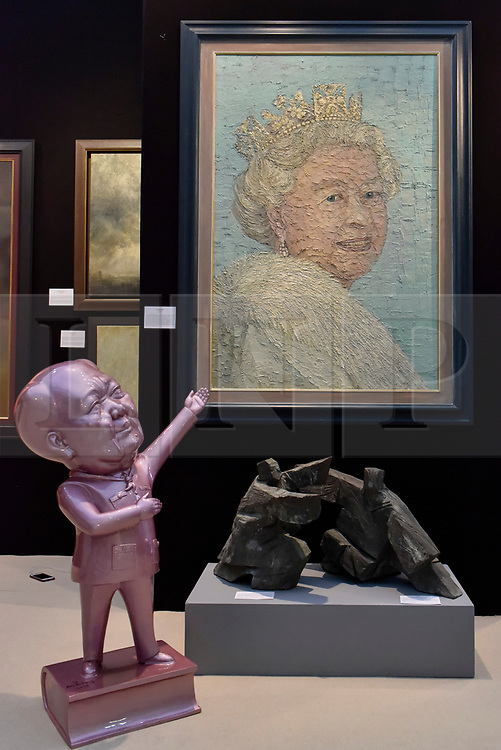 "© Licensed to London News Pictures. 27/06/2017. London, UK.  ""Broadcast Exercise VII"" by Ren Si Hong, a statue of Chairman Mao, seen below ""Queen Elizabeth II"" by Pip Todd Wormoth at The Arts & Antiques Fair taking place at Olympia in Kensington.  The event is the UK's largest and most established art and antiques fair and runs until 2 July. . Photo credit : Stephen Chung/LNP"