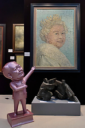"""© Licensed to London News Pictures. 27/06/2017. London, UK.  """"Broadcast Exercise VII"""" by Ren Si Hong, a statue of Chairman Mao, seen below """"Queen Elizabeth II"""" by Pip Todd Wormoth at The Arts & Antiques Fair taking place at Olympia in Kensington.  The event is the UK's largest and most established art and antiques fair and runs until 2 July. . Photo credit : Stephen Chung/LNP"""