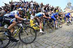 The peloton led by Kasper Asgreen (DEN) and Zdenek Stybar (CZE) Deceuninck-Quick Step, Silvan Dillier (SUI) AG2R La Mondiale and MAtteo Trentin (ITA) Mitchelton-Scott on the Muur Kapelmuur Geraardsbergen during the 2019 Ronde Van Vlaanderen 270km from Antwerp to Oudenaarde, Belgium. 7th April 2019.<br /> Picture: Eoin Clarke | Cyclefile<br /> <br /> All photos usage must carry mandatory copyright credit (© Cyclefile | Eoin Clarke)