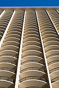 The balconies (lanais) of a tall hotel in Waikiki.