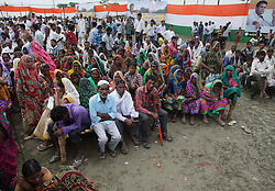September 16, 2016 - Kaushambi, India - Indian loacal residents and supporters sit on cots (Khat) as they gather to take part in Indian Congress party's vice president and leader Rahul Gandhi's public meeting, popularly known as Khaat Panchayats, where organizers make arrangement of thousands of Khaats (cots) for the people attending the meetings to sit on them, while listening to their leader, in tenwa village , in Kaushambi on September 15, 2016.Khaat (rustic Hindi word for cot) is symbol of villages in general and of farmers in particular. By naming the public meetings as Khaat Panchayats arranging khaats during the meetings, a strategy has been drawn to connect Rahul and Congress with the farmers of Uttar Pradesh and thus reap the electoral harvests during the next assambly elections. (Credit Image: © Ritesh Shukla/NurPhoto via ZUMA Press)