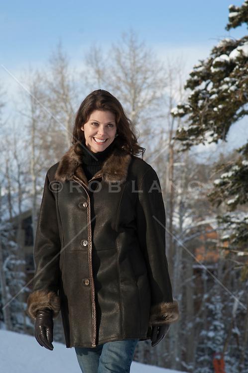 woman outdoors in a beautiful winter coat