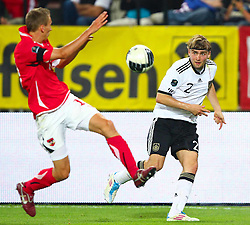 03.06.2011, Ernst Happel Stadion, Wien, AUT, UEFA EURO 2012, Qualifikation, Oesterreich (AUT) vs Deutschland (GER), im Bild Zweikampf zwischen Florian Klein, (AUT, #17) und Marcel Schmelzer, (GER, #2)  // during the UEFA Euro 2012 Qualifier Game, Austria vs Germany, at Ernst Happel Stadium, Vienna, 2010-06-03, EXPA Pictures © 2011, PhotoCredit: EXPA/ T. Haumer