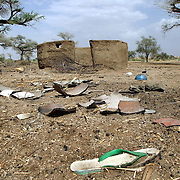 June 9, 2004 - A burned and abandoned village near Kass, South Darfur. The thatch roofs of the round huts of villagers have been burned off. CARE, an international aid organization, is helping to feed 400,000 displaced people in Darfur. Photo by Evelyn Hockstein/CARE