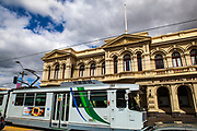 Tram passing the City of Northcote Municipal Offices, Melbourne, Victoria, Australia. Late 19 century building designed by architect George R Johnson, built between 1888 and 1891.