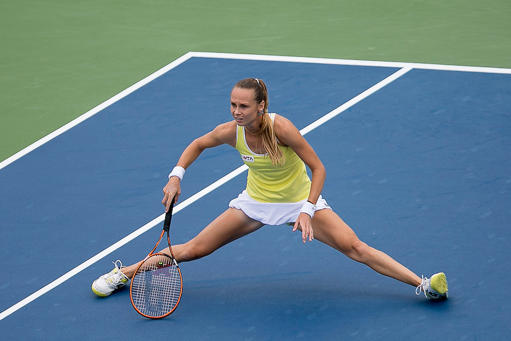 August 22, 2014, New Haven, CT:<br /> Magdalena Rybarikova lunges for a forehand during the semi-final match against Camila Giorgi on day eight of the 2014 Connecticut Open at the Yale University Tennis Center in New Haven, Connecticut Friday, August 22, 2014.<br /> (Photo by Billie Weiss/Connecticut Open)