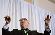William Hilyard conducts the audience in singing Ohio University's alma mater after accepting the Distinguished Service Award at the Alumni Awards Gala on October 6, 2017.