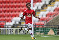 Manchester United's Angel Gomes celebrates scoring his side's third goal of the game