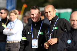 Mechanic Bostjan Kavcnik and physiotherapist Danijel Kvasina during the Women´s Junior Road Race on day five of the UCI Road World Championships on September 23, 2011 in Copenhagen, Denmark. (Photo by Marjan Kelner / Sportida Photo Agency)