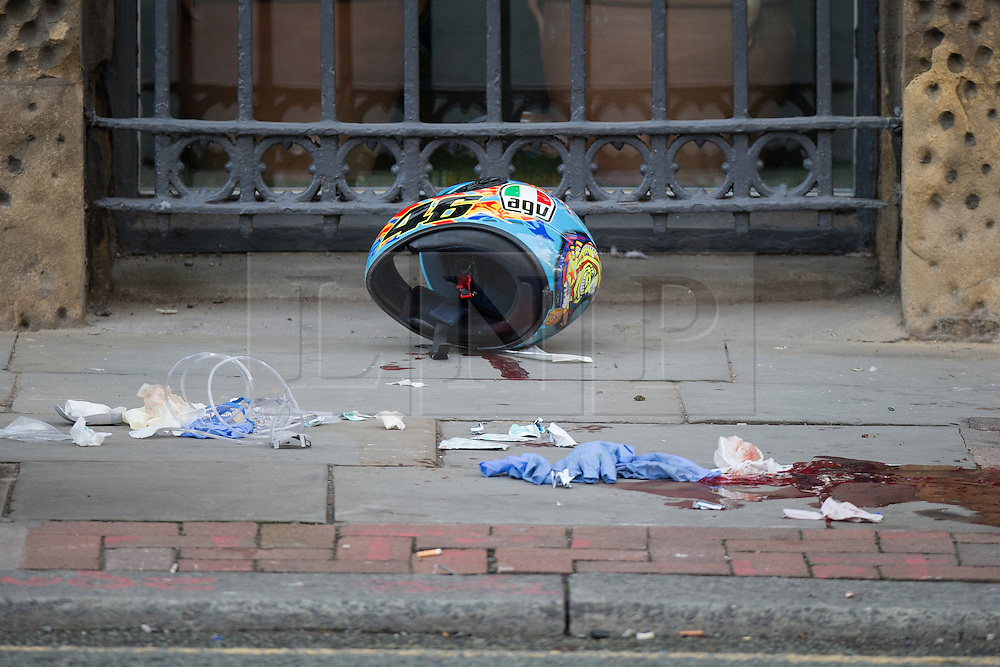 © Licensed to London News Pictures . 22/08/2015 . Manchester , UK . The scene of a  fatal RTA on Princess Street in central Manchester . Yesterday (22nd August 2015) a 26 year old motorcyclist died after hitting a wall , after losing control of his Yamaha R6 . Photo credit : Joel Goodman/LNP