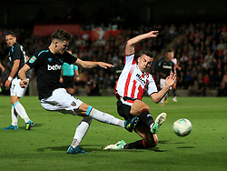 Kevin Dawson of Cheltenham Town blocks a Sam Byram of West Ham United shot - Mandatory by-line: Paul Roberts/JMP - 23/08/2017 - FOOTBALL - LCI Rail Stadium - Cheltenham, England - Cheltenham Town v West Ham United - Carabao Cup