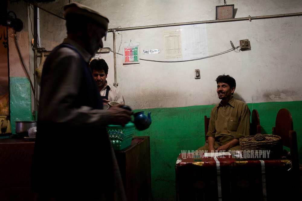 Pakistani men gather in a tea house on May 8, 2011 in Abbottabad, Pakistan. The town of Abbottabad became infamous after the US launched a midnight raid on a compound housing Osama bin Laden in the garrison town, on May 2, 2011. The operation, code-named Operation Neptune Spear, was launched from neighbouring Afghanistan and resulted in the killing of one of the world's most notorious terrorists and who claimed responsibility for the 9/11 attacks in the US. U.S. forces took bin Laden's body to Afghanistan for identification, then dumped it the Arabian Sea. The Pakistani military has since been widely suspected as having prior knowledge of his whereabouts as the compound was less than a kilometre from the country's biggest military academy.  (Photo by Warrick Page)