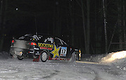 Open class second place finishers Antoine L'Estage and Nathalie Richard negotiate a hairpin turn during one of the nighttime stages of the 2010 Sno-Drift road rally just ouside Atlanta, MI.