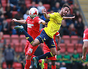 Oxford midfielder Jordan Graham and Leyton Orient midfielder Sammy Moore compete for a high ball during the Sky Bet League 2 match between Leyton Orient and Oxford United at the Matchroom Stadium, London, England on 17 October 2015. Photo by Bennett Dean.
