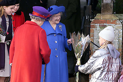 .TTP11-AP-ROYALS/SANDRINGHAM-DIG..PIC BY ANDREW PARSONS . THE ROYAL FAMILY ON CHRISTMAS DAY  AT CHURCH IN SANDRINGHAM , NORFOLK.  THE QUEEN AND THE QUEEN MOTHER RECEIVING FLOWERS FROM CHILDREN AFTER THE SERVICE Royals in Sandringham..The Royal Family on Christmas Day at church in Sandringham, Norfolk. The Queen and the Queen Mother 2000. Photo by Andrew Parsons/i-Images.Royals in Sandringham..The Royal Family on Christmas Day at church in Sandringham, Norfolk. The Queen and the Queen Mother 2000. Photo by Andrew Parsons/i-Images.Queen Mother at Sandringham attending church service on Christmas Day 2000. Photo by Andrew Parsons/i-Images.Queen Mother and Queen at Sandringham attending church service on Christmas Day 2000. Photo by Andrew Parsons/i-Images.