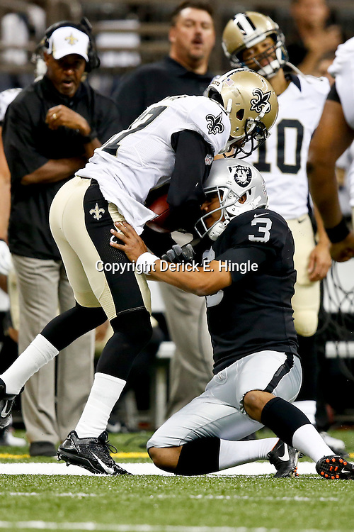 Aug 16, 2013; New Orleans, LA, USA; Oakland Raiders kicker Eddy Carmona (3) tackles New Orleans Saints wide receiver Preston Parker (87) during the second half of a preseason game at the Mercedes-Benz Superdome. The Saints defeated the Raiders 28-20. Mandatory Credit: Derick E. Hingle-USA TODAY Sports