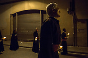 Penintents during the Silence night procession in Maundy Thursday at the city center of Mataró city (Barcelona), during Easter 2015. Eva Parey/4SEE.