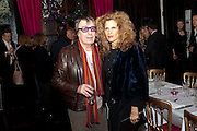 BILL WYMAN; SUZANNE WYMAN, Bitch- Auction and fundraiser for the dog charity Care. The Cuckoo Club, London. 7 December 2010. -DO NOT ARCHIVE-© Copyright Photograph by Dafydd Jones. 248 Clapham Rd. London SW9 0PZ. Tel 0207 820 0771. www.dafjones.com.