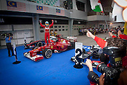Fernando Alonso of Scuderia Ferrari cheers after finished first during the 2012 Malaysian Formula One Grand Prix  at the Sepang International Circuit, 25th March 2012.
