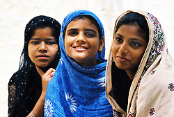 Pakistan, Karachi, 2004. These three girls are daughters of women who broke away from harmful influences to find help at the Edhi Foundation.