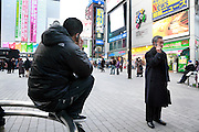 people talking on there mobile phone Tokyo, Yurakucho
