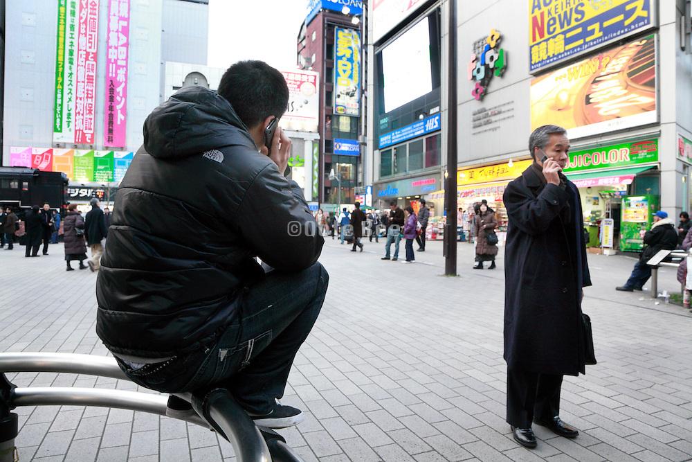 people talking on there mobile phone Tokyo, Yurakucho