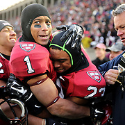 Andrew Fischer, (left), Harvard, celebrates with team mate Chris Evans after a last minute interception secured victory for Harvard during the Harvard Vs Yale, College Football, Ivy League deciding game, Harvard Stadium, Boston, Massachusetts, USA. 22nd November 2014. Photo Tim Clayton