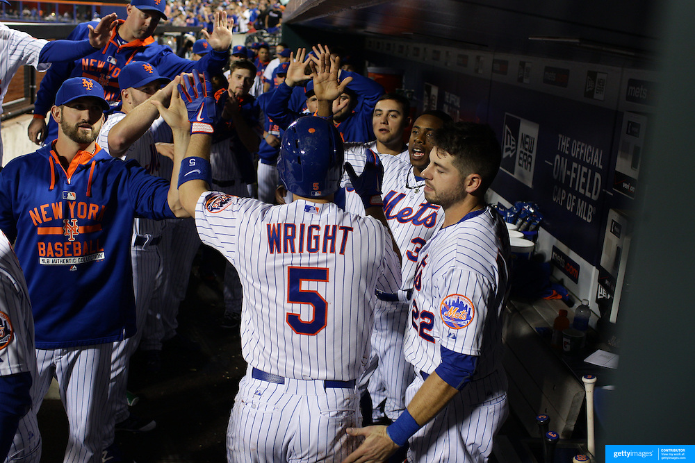 David Wright, New York Mets is congratulated by team mates in the dugout after hitting a home run during the New York Mets Vs Atlanta Braves MLB regular season baseball game at Citi Field, Queens, New York. USA. 22nd September 2015. Photo Tim Clayton