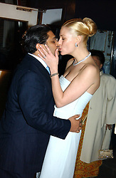 The HON.ANGAD PAUL and his bride MICHELLE BONN leaving a reception to celebrate the wedding of Lord Paul's youngest son Angad to Michelle Bonn held at Lancaster House, London on 21st March 2005.<br />