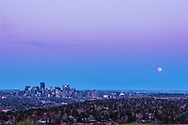 The Full Moon rising over the skyline of Calgary, on the evening of May 3, 2015. On this night the Moon rose about 15 minutes before sunset and so I was hoping to catch the buildings lighting up wth the last rays of the setting Sun as the Moon was rising behind them. However, horizon haze in the west and east obscured both the low Sun and low Moon. Here, the Moon appears as it rises out of the haze and still a pink tint. This is a frame from a 430-frame time-lapse sequence taken from the CFCN grounds on Broadcast Hill west of the city. This is with the Canon 60Da and 50mm lens. There was not an accessible location to the north that would have put the Moon rising over the city itself. That geometry won't happen until September's Full Moon which is also a total eclipse night in the evening after moonrise.