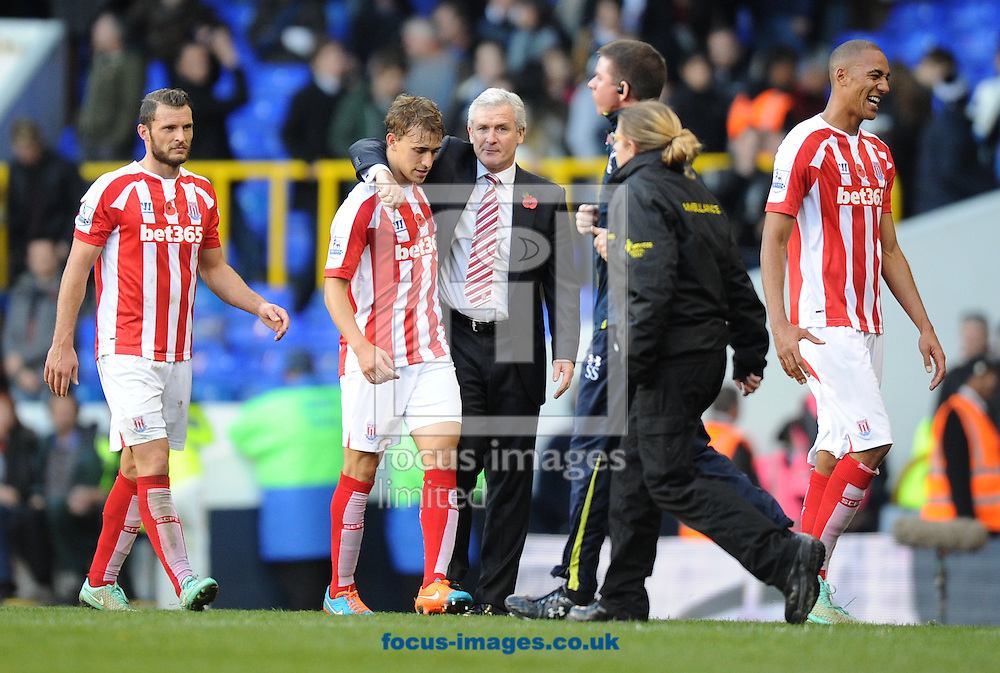 Manager Mark Hughes congratulates Marc Muniesa after the Barclays Premier League match at White Hart Lane, London<br /> Picture by Alan Stanford/Focus Images Ltd +44 7915 056117<br /> 09/11/2014