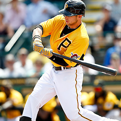 March 22, 2012; Bradenton, FL, USA; Pittsburgh Pirates left fielder Alex Presley (7) singles against the Tampa Bay Rays during the bottom of the first inning of a spring training game at McKechnie Field. Mandatory Credit: Derick E. Hingle-US PRESSWIRE