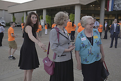 Kentucky Secretary of State Alison Lundergan Grimes, left, says hello to Nancy Jo Kemper, right, and The 53rd Annual Kentucky Farm Beureau Country Ham Breakfast was protested by Congressman John Yarmuth, Chris Hartman and other members of various fairness organizations outside the South Wing of the Kentucky Fair and Exposition Center, Thursday, Aug. 25, 2016 in Louisville.