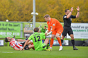Lincoln City Defender, Luke Waterfall (5) picks up a knock with Forest Green Rovers Midfielder, Darren Carter (12) during the Vanarama National League match between Forest Green Rovers and Lincoln City at the New Lawn, Forest Green, United Kingdom on 19 November 2016. Photo by Adam Rivers.