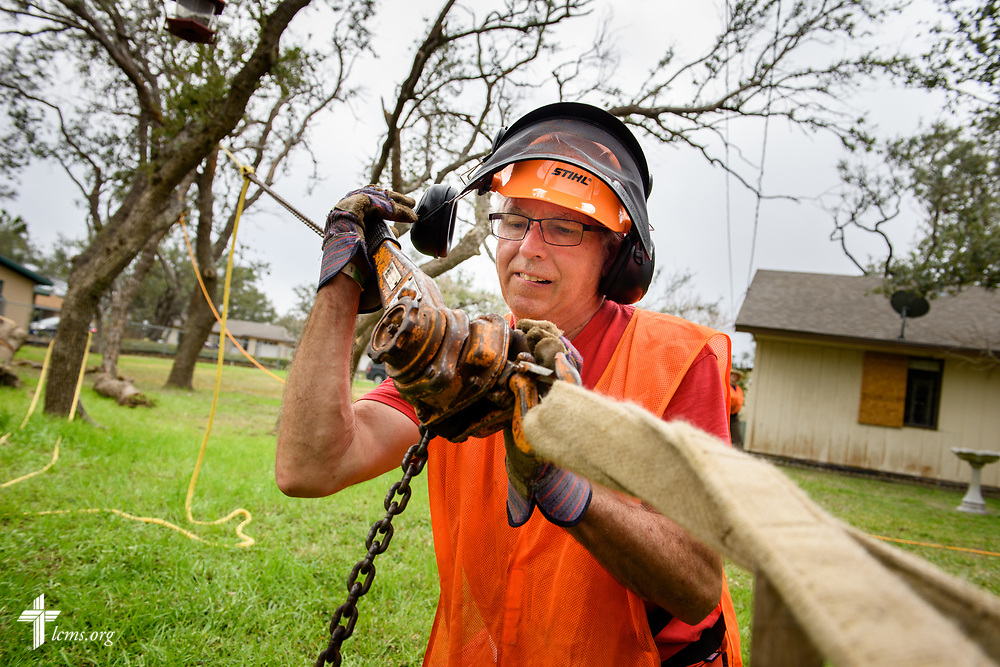Neal Brady, a volunteer from St. Marys, Ohio, helps fell a damaged tree on Tuesday, Feb. 6, 2018, at a home in Rockport, Texas. Neal and his wife Allison were part of a small team chainsawing and removing damaged trees leftover from Hurricane Harvey. LCMS Communications/Erik M. Lunsford