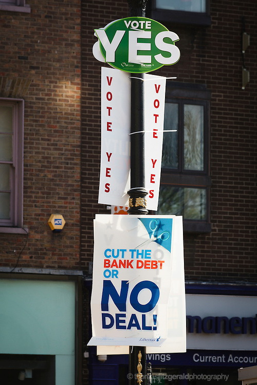 A collection of yes and no posters both supporting and objecting to the fiscal treaty on a street light pole in the Stephen's Green area of Dublin City