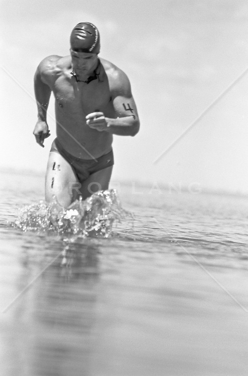 competitive athlete running in a race in water