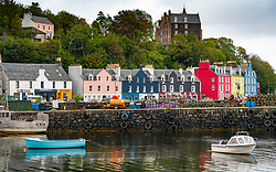 View of colourful buildings along waterfront at Tobermory harbour on Mull, Argyll & Bute, Scotland, UK