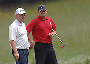 Brothers Jeffery (left) and Steven Cuzzort of Grosse Ile wait for their final round playing partner to line up a putt on the par 4, 9th hole of Boyne Mountains Alpine course during final round play at the 2009 Michigan PGA Tournament of Champions.
